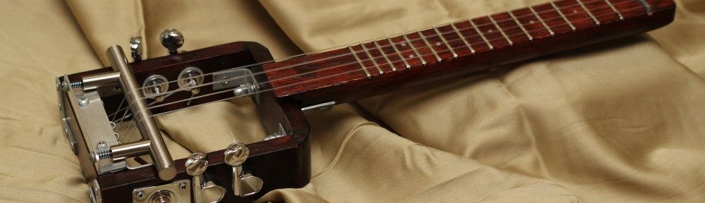 DIY Travel Ukulele:  (2011) - I wanted to make a ukulele with parts and wood that is readily available.  I added a rod piezo to the bridge to amplify it.  It's great for traveling.  I made plans for it which are available for free by emailing circuitsandstrings@gmail.com.