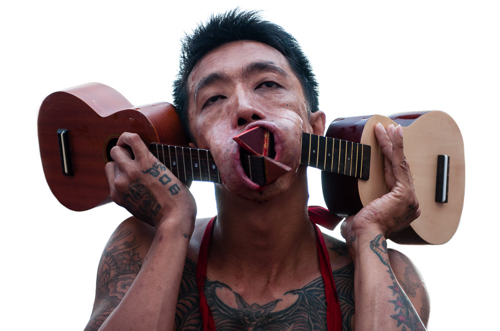 Ukulele face piercings from Phuket, Thailand